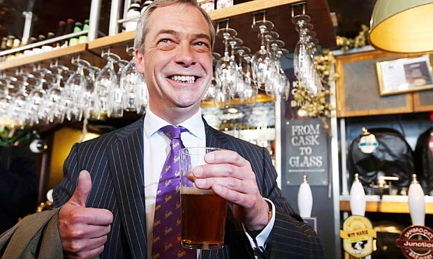 Ukip leader Nigel Farage with a pint of beer in a pub